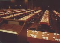 A picture of tables set for an event in the Mankato State University Centennial Student Union Ballroom, 1980s.