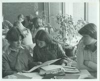 A picture of three Mankato State University students studying together in the Centennial Student Union, 1970s.