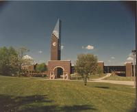 A picture of the Mankato State University Alumni Arch and Plaza and the Ostrander Student Memorial Bell Tower, 1990s.