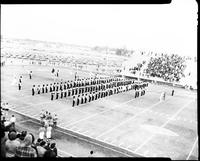 Mankato State College Marching Band on Blakeslee Field in Formation Led by Clayton H. Tiede, Fall 1969-1970