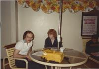 A picture of two Mankato State University students reading and studying in the Centennial Student Union, 1980s.