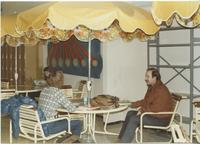 A picture of two Mankato State University students sitting at a table together in the MSU Centennial Student Union, 1980s.