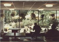 A picture of two people sitting in the Mankato State University Centennial Student Union, 1980s.
