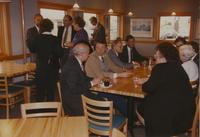 A group of men and women at a reception near Mankato State University, 1990-10-08.