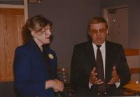 Dr. Margaret R. Preska engaged in a serious conversation with her peer at a reception near Mankato State University, 1990-10-08.