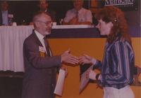 Student receiving certificate for participating in the Computer and Information Science fair in the Centennial Student Union at Mankato State University, 1991-05-15.