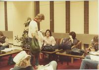 A group of Mankato State University students gathered in the Centennial Student Union talking and studying, 1980s.