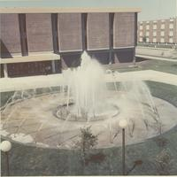 A picture taken from the Mankato State College Centennial Student Union looking at the MSC Memorial Library and university fountain, 1970s.