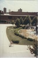 A picture taken from the Mankato State College Memorial Library of the Centennial Student Union and university fountain, 1970s.