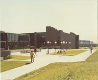 A picture of Mankato State University students relaxing and walking outside of the Trafton Science Center, 1970s.