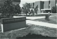 A picture of the Mankato State University Centennial Student Union sign and building, university fountain, and MSU Memorial Library, 1980s.