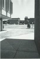 A picture of the Mankato State University Trafton Science Center taken from the sidewalk between Armstrong Hall and Morris Hall, 1970s.