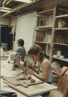 Female ceramics student working with slab construction, Mankato State University