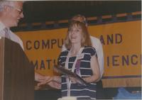 Wendy Schuller receiving a plaque at the Computer and Information Science event at Mankato State University, 1991-05-15.