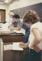 Several chemistry students working with files, Mankato State University