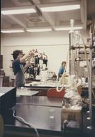 Male and female student working in chemistry lab, Mankato State University
