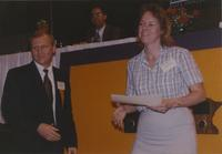 Virginia (right) receiving a certificate in the Centennial Student Union at Mankato State University, 1991-05-15.