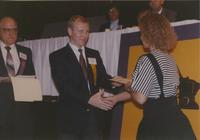 A woman receiving a certificate for participating in a event at Mankato State University, 1991-05-15.