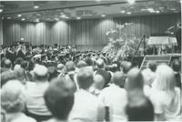 A picture of the crowd watching the Mankato State University graduates during a 1976 commencement ceremony in the Centennial Student Union Ballroom.