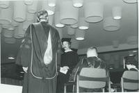 A picture of some people gathered on stage in the Mankato State University Centennial Student Union for a 1976 commencement ceremony.