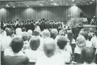 A picture of the crowd watching the Mankato State University students participating in the 1976 commencement ceremony in the Centennial Student Union.