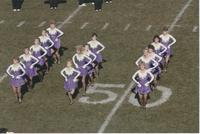 A picture of the Mankato State University Danceline team dancing on a football field, 1990.