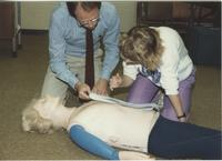 Girl, in the Emergency Medical Training Program, practices on a practice doll at Mankato State University.