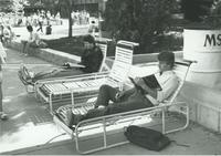 Students sitting outside of the Centennial Student Union (CSU) at Mankato State University