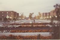 A picture of Mankato State College students walking on the Campus Mall during the evening, 1970s.