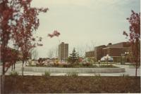 A picture taken from the Mankato State College Campus Mall looking at the Centennial Student Union and Tower A of the Gage Residence Community, 1970s.