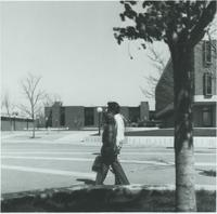 A picture of two Mankato State College students walking on the Campus Mall, 1970s.