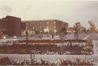An evening picture of Mankato State University students walking on the Campus Mall near the Centennial Student Union and MSU Memorial Library, 1980s.