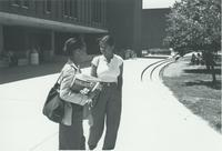Two female students talking outside of the Centennial Student Union (CSU) at Mankato State University
