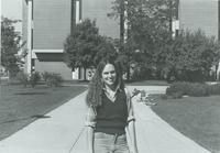 A student posing for the camera outside of the Memorial Library at Mankato State University