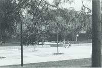 A picture of two Mankato State College students walking on the Campus Mall after leaving the Armstrong Hall academic building, 1970s.
