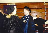 College President Margaret R. Preska at commencement with college students at Mankato State University, 1991-06-07.