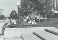 Students sitting outside of Armstrong and Nelson Hall at Mankato State University