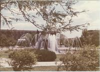 A picture of the Mankato State University campus fountain, Armstrong Hall academic building, Campus Mall and Centennial Student Union building, 1980s.
