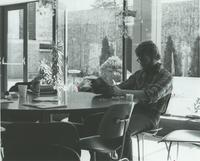 A picture of a Mankato State University student reading in the Centennial Student Union, 1970s.