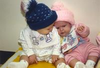 Two baby girls at the Children's House at Mankato State University, 1989-12-13.
