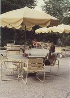 A picture of two people relaxing outside of the Mankato State University Centennial Student Union, 1985-1990.
