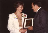 Mary Dooley receiving an award at Mankato State University, 1990-05-31.