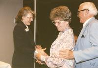Former Univeristy President Margaret Preska shaking hands with a women at Mankato State University, 1990-06-08.