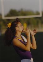 A cheerleader practices cheering before a Maverick game at Mankato State University, 1990-09-15.