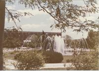 A picture of the Mankato State University students walking on the Campus Mall near the fountain, 1980s.