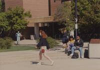 Students outside of the Memorial Library at Mankato State University, 1991-05-08.