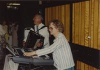 A man and woman playing instruments at Mankato State University, 1991-05-18.