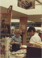 A picture of two women looking at textbooks in the Mankato State University bookstore, 1985.