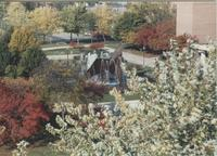A picture of the Mankato State University Memorial Library, Campus Mall and university fountain during the fall season, 1980s.