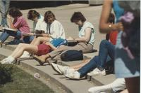 Students sitting on some steps doing homework at Mankato State University